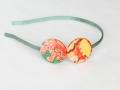 Diadema con botones forrados en colores amarillo, naranja y verde agua. Talla única | gingerytulula.com