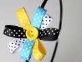 Diadema con flor hecha de cintas en varios colores con lunares a juego. Talla única | gingerytulula.com