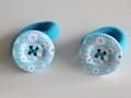 Coletero con botón color azul con dibujo de colores | gingerytulula.com